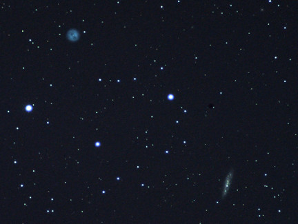 A photo of M97 (Owl Nebula) and M108.