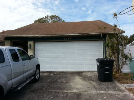 The newly painted garage door.